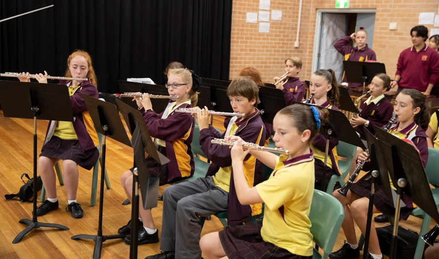 Group of school students playing instruments in band