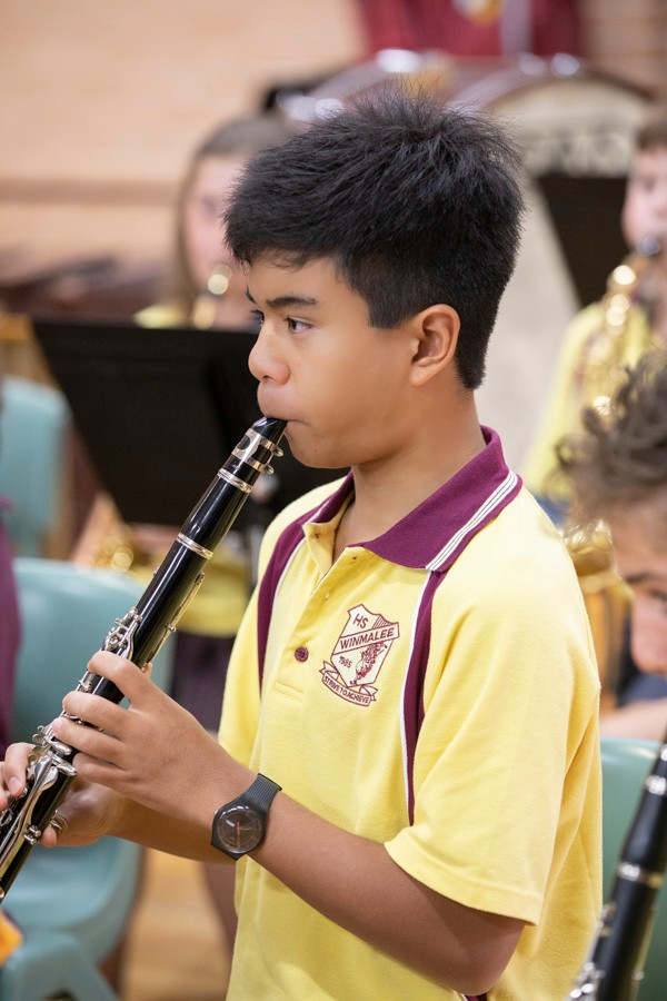 Male student playing the clarinet