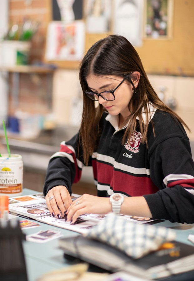 Female student working on her artwork in Visual Arts