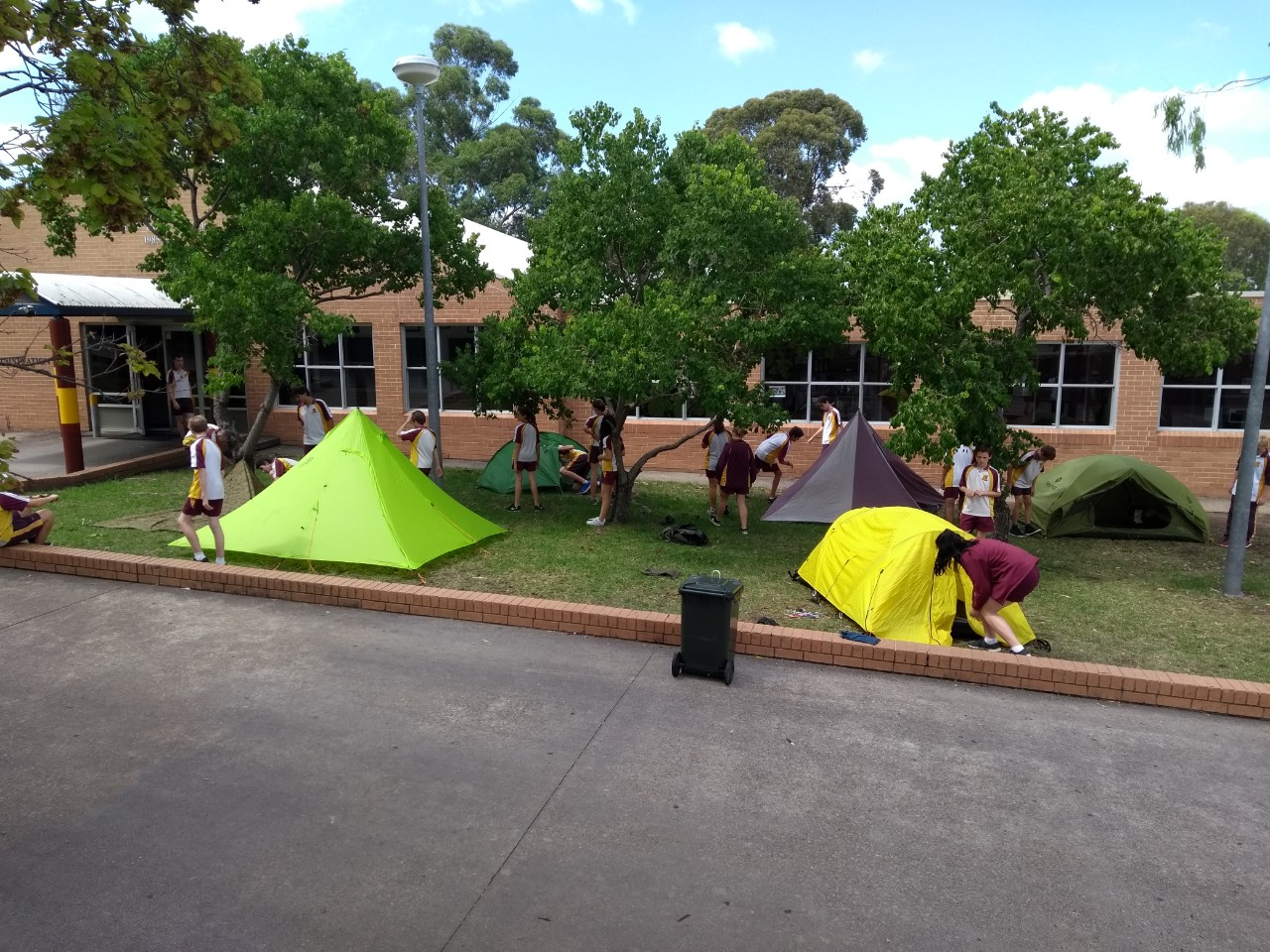 Students practising how to put tents up in school grounds for Duke of Edinburgh program